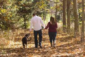 Couple walking dog